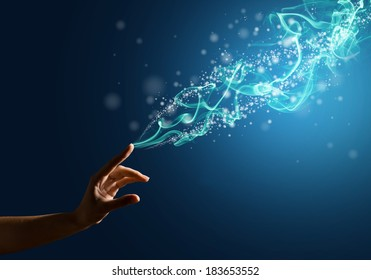 magic hand, conceptual image with glow on a colored background