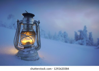 magic lantern in winter landscape on the mountain peak - oil lamp