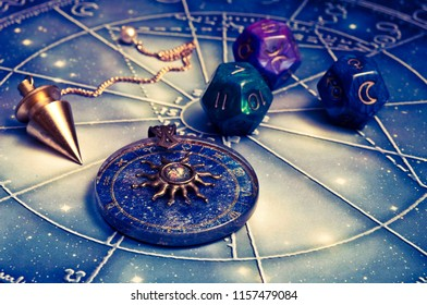 magic pendulum, horoscope with zodiac signs and astrology dice like esoteric concept