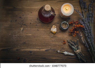 Magic potion. Alternative herbal medicine. Shaman table with copy space. Druidism concept. Witch doctor desk background with copy space.