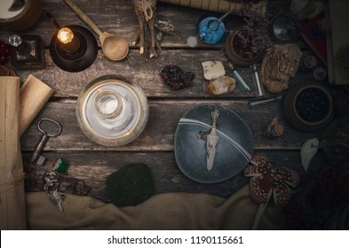 Magic potion in the vial on the wizard table. Witchcraft concept.