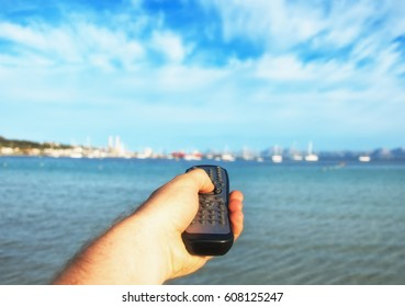 Magic remote control. Image that you can choose anything you want, for example your vacations near the sea.