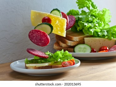 magic sandwich with salami and cheese on wooden table