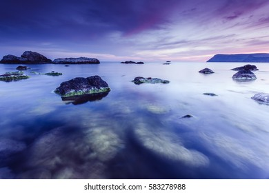 Magic sea in the evening light on a gloomy sky. Dramatic and gorgeous scene. Location place Black Sea, Crimea, Ukraine, Europe. Blue toning effect. Artistic picture. Discover the world of beauty.