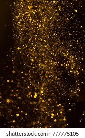 Magic sparkling golden dust rain vertical abstract background