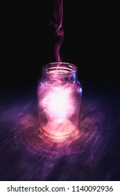magic spell in a glass jar on a dark background