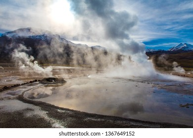 Magic sunrise among steaming geysers