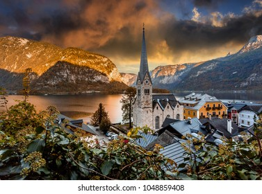 magic Sunset over the Halstatt. Picturesque overcast clouds under sunlit. Dramatic unusual scene. Unsurpassed nature in the Austrian Alps. Salzkammergut, Upper Austria. Austrian Alps. Creative image.
