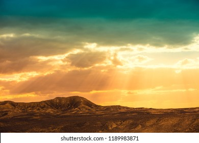 Magic sunset over mountain in Negev desert, wild nature Israel.