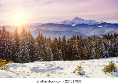 Magic sunset in the snowy mountains