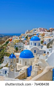 Magic view of Oia on island of Santorini in Greece. Traditional architecture with famous blue churches.