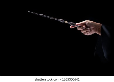 Magic wand in black.miracle magical stick Wizard tool. - Shutterstock ID 1655300641