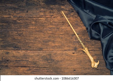 Magic wand on wooden table, Magic wand Wizard tool on vintage wooden background.