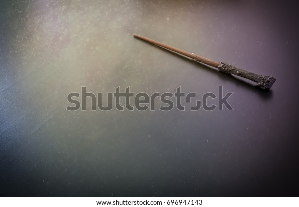 Magic wand on wooden table, Wizard tool.