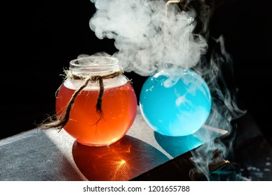 Magic and wizardry concept. Set of sorcery book and magic potions. Health and mana potion. Alchemy and halloween concept.