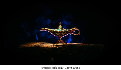 Magical Aladdin genie lamp with blue smoke