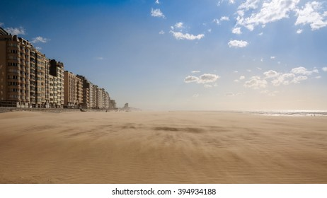 Magical alien sand storm on the beach in Oostende on the North sea (panoramic sunset view). The first line of the most luxurious hotels along the Belgian coast. Ostend, Belgium.