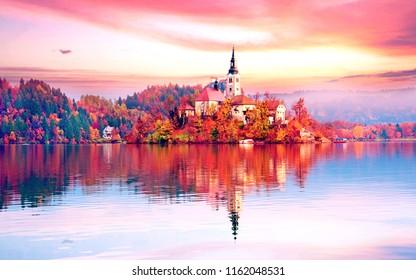Magical autumn landscape with the island on Lake Bled (Blejsko jezero). Julian Alps, Slovenia, Europe.