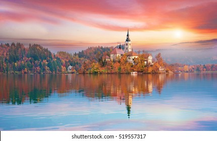 Magical autumn landscape with the island on Lake Bled (Blejsko jezero). Julian Alps, Slovenia, Europe. Attractions. Tourist places of pilgrimage. (Meditation,inner peace, harmony, honeymoon - concept)