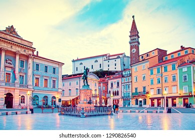 magical beautiful inspirational scenic city landscape on the central square with a monument and an ancient watch tower in Piran, the tourist center of Slovenia