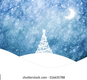 Magical blue colored sky with realistic heavy snowfall, Christmas and New Years Holiday winter landscape scene with decorative bright christmas trees on hill and bright moon on the sky.