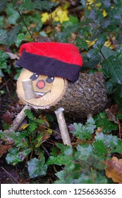 Magical Catalan Tio on his own in the woodland forest waiting for an owner to take home for December until the 24th. When he poos presents. Red hat, painted face. Oak leaves.