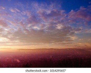 Magical cloudy sunrise landscape over the city of Cluj-Napoca from Cluj county with fog