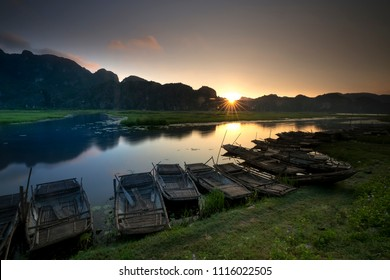 magical dawn on the Van Long wetland reserve with the sun's rays and the reflection of the water. Van Long wetland reserve in Ninh Bình province, Vietnam