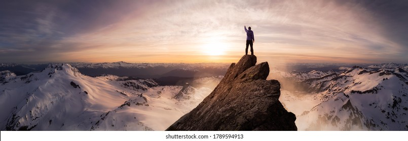 Magical Fantasy Adventure Composite of Man Hiking on top of a rocky mountain peak. Background Landscape from British Columbia, Canada. Sunset or Sunrise Colorful Sky - Shutterstock ID 1789594913