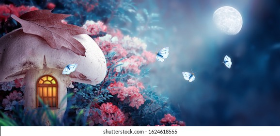 Magical fantasy elf or gnome mushroom house with window in enchanted fairy tale forest, fabulous blooming rose flower garden, flying butterflies on mysterious blue background, shine moon ray in night