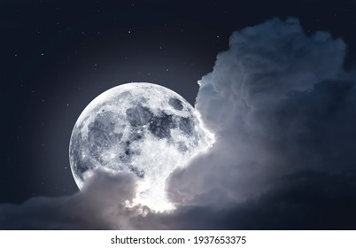 Magical Fullmoon with clouds and stars