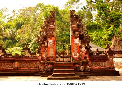 Magical hindu temple in the rain forest at Tirta Pura Empul in sunset lights, Ubud on Bali, Indonesia