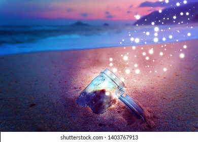 Magical Jar Open On Beach at Night Releasing Star Dust Creative Concept