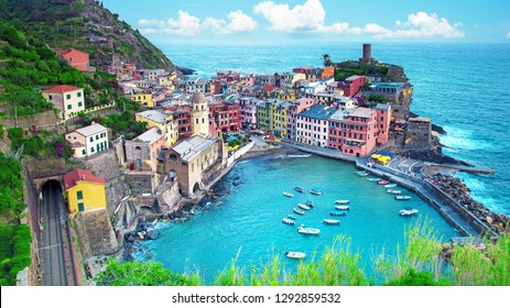 Magical landscape with boats in the bay and colored houses on the rock in Vernazza, Cinque Terre, Italy. beautiful places