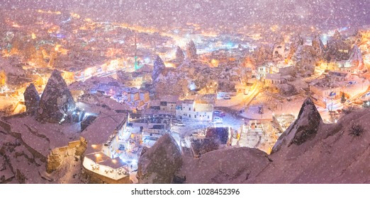 A magical landscape of Cappadocia in the winter during a snowfall.