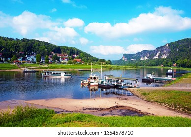 A magical landscape with ferries on the river Elbe near Rathen, Germany, Europe (Sachsische Schweiz)