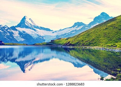 A magical landscape with a lake in the mountains in the Swiss Alps, Europe. Wetterhorn, Schreckhorn, Finsteraarhorn et Bachsee. ( relaxation, harmony, anti-stress - concept).