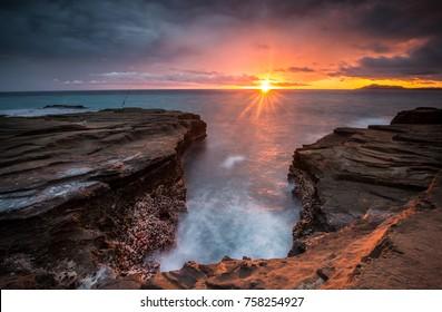 Magical long exposure sunset shot in Honolulu on Oahu, Hawaii