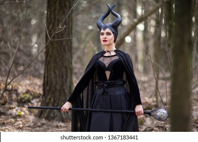 Magical Maleficent Character Posing with Crook in Spring Empty Forest.Horizontal Image Composition