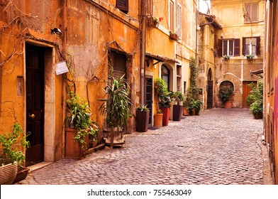 Magical Mediterranean street with cobbled road in the Trastevere quarter of Rome, Italy