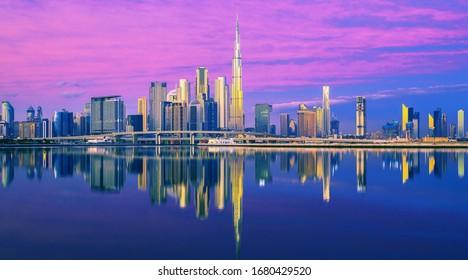 Magical and modern Dubai city skyline at sunrise, United Arab Emirates