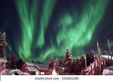 The Magical Northern Lights dancing over a small Finnish village in Lapland