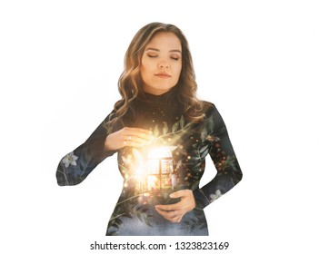 Magical portrait of young beautiful woman with window full of bright light and flowers inside a heart. Conceptual esoteric image showing beauty of soul, inner world. Double exposure effects. Isolated