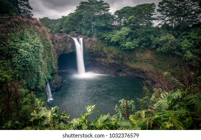 Magical Rainbow Falls waterfall deep in the jungles of Hawaii on the Bis Island