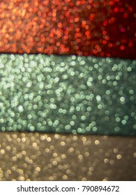 Magical red, green and silver background with sparkles and bokeh