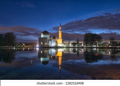 Magical sunrise hour at floating mosque, Masjid As Salam, Puchong, Malaysia during haze weather with reflection on the water lake