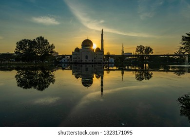 Magical sunrise hour at floating mosque, Masjid As Salam, Puchong with reflection on the water lake.