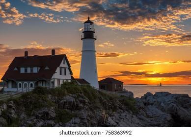 Magical sunrise at the iconic Portland Head Light. Portland, Maine.