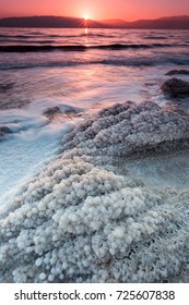 Magical sunrise light the salt crystal formations on the shore of the dead sea the lowest point on earth