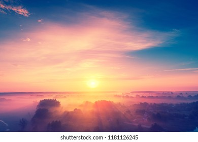 Magical sunrise over lake. Misty morning, rural landscape